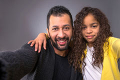 Black father taking selfies with his daughter Stock Image