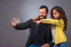 Black father taking selfies with his daughter Royalty Free Stock Photos