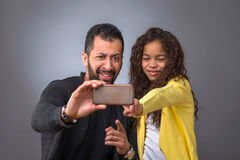 Black father taking selfies with his daughter Stock Photos