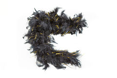 Black feather boa with gold tinsel Royalty Free Stock Images