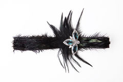 Black feather headband on white Royalty Free Stock Photo
