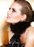 Black feathers and blond woman Royalty Free Stock Image