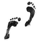 Black feet. Impression of a pair of feet in black ink Royalty Free Stock Images