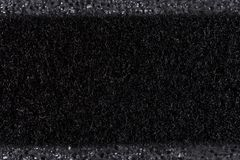 Black felt macro on polyurethane foam macro closeup. Black felt on polyurethane foam surface macro closeup Stock Images