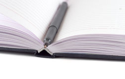 Black felt-tip lying on opened notebook. (isolation Stock Image