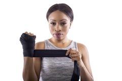Black Female Athlete Preparing on a White Background Stock Photo
