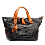 Black female bag with orange handles Royalty Free Stock Images