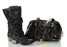Black female boots and bag. Stock Photos