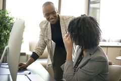 Black Female Businesswomen Coworkers or Job Training. Black African American businesswomen or coworkers together in an office doing teamwork or job training stock photos