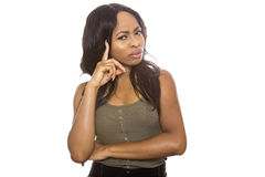 Black Female Confused. Black female isolated on a white background displaying facial confused expressions. She is young and of African American ethnicity royalty free stock image