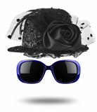 Black female hat and sunglasses isolated on white Royalty Free Stock Photo
