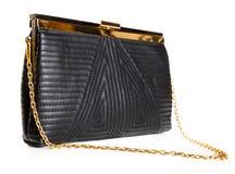 Black female leather bag isolated over white background Stock Photography