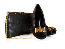 Black female leather bag and velvet shoes isolated over white background Royalty Free Stock Image
