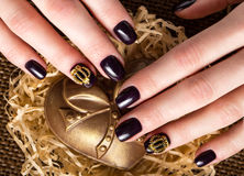 Black female manicure nails closeup with crown.  stock images