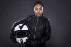 Black Female Biker in Leather Jacket Holding a Helmet Royalty Free Stock Photography