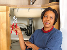 Black female plumber Royalty Free Stock Photos