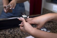 Black Female Putting on Rings Stock Image