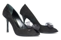 Black female shoes with decorations Royalty Free Stock Photos