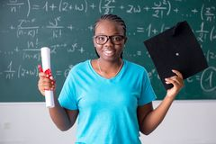 The black female student in front of chalkboard. Black female student in front of chalkboard royalty free stock image