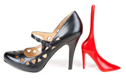 Black feminine loafer and red shoehorn Royalty Free Stock Photo