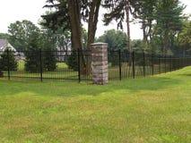 Black fence around property Royalty Free Stock Photography