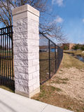 Black fence and cornerstone Royalty Free Stock Photos