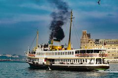 Black Ferry in Istanbul. Black Ferry sailing on the sea Stock Photo