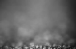 Black Festive Abstract background. Christmas twinkled bright bokeh Stock Images