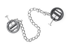 Black fetish nipple clamps with chain isolated on white. Background royalty free stock images