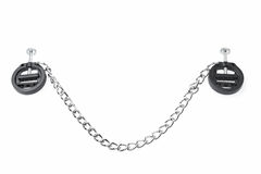 Black fetish nipple clamps with chain isolated on white Stock Image