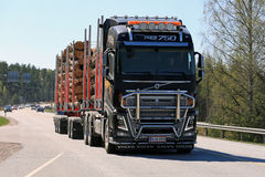 Black FH16 750 Logging Truck on the Road Stock Image