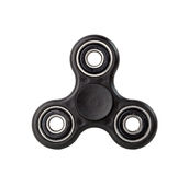 Black Fidget Spinner on white background royalty free stock photo