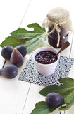 Black fig jam. Home made organic fig jam and fresh figs on a wooden table royalty free stock image