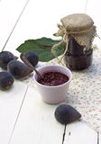 Black fig jam. Home made organic fig jam and fresh figs on a wooden table stock photos