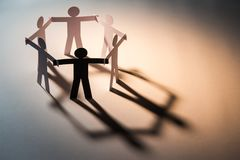 Weakness in six team. Black figure in closed joining of six paper figure on light background. in concept of business, cooperation and weakness Stock Photos