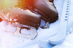 Black figure skates lying in the snow and bright sun Stock Photography