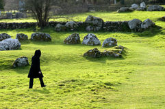 Black figure and stone circle Stock Image