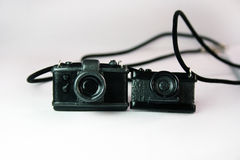 Black figures cameras on the table royalty free stock images