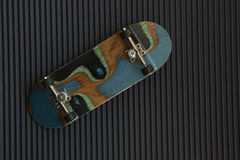 Black fingerboard on dark Royalty Free Stock Photo