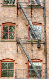 Black Fire Escape on Red Brick Building Royalty Free Stock Image