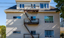 Black Fire Escape on Wood Condos Stock Images