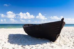 Black fishing boat on the beach on Ruegen Island Royalty Free Stock Photo