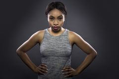 Black Fitness Trainer on a Dark Grey Background Royalty Free Stock Photos