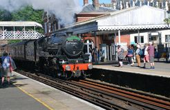 Black Five steam locomotive, St. Leonards. London Midland and Scottish Railway Class 5 steam locomotive, 44871, hauls an excursion train through St. Leonards stock images