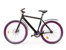 Black fixed urban bike with violet whells isolated with clipping royalty free stock image