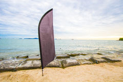Black flag for advertising at the beach. stock photos