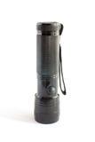 Black flashlight. On white background Stock Image