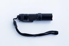 Black flashlight on a white background stock image