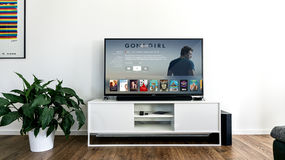Black Flat Screen TV on White Wooden TV Rack in Living Room Stock Photo