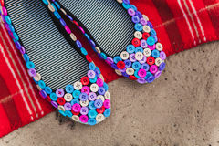 Black flat shoes made from textile covered with colored buttons. Handmade stock images